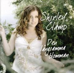 Shirley Clamp - Den Langsamma Blomman
